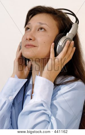 Girl In A Blue Shirt With Headphones