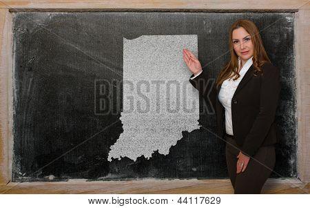 Teacher Showing Map Of Indiana On Blackboard