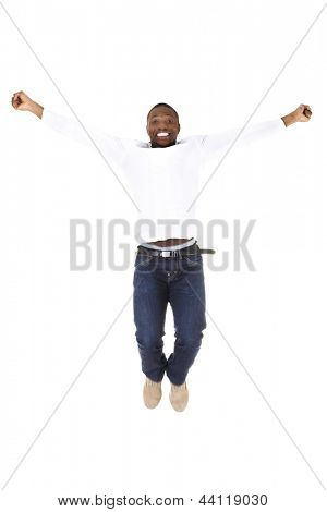 Young happy afro american man jumps in joy over white background.
