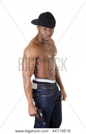 Afro american man standing with gun in hand. Thug and gangsta concept.