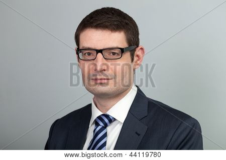 Businessman With Glasses, Suit And Tie