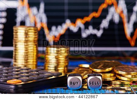 Dices Cubes With The Words Sell Buy Golden Coins, Calculator And Financial Chart As Background. Sele