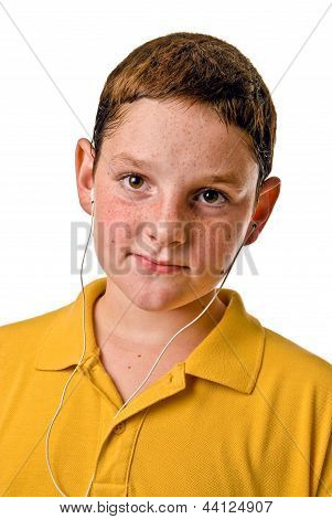 Young boy listening to mp3 player