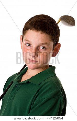 Young boy with golf club
