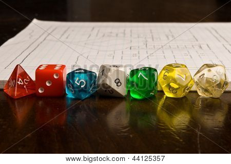 Multicolored role play dice on wooden table top