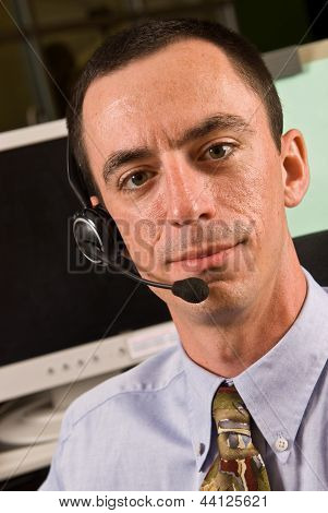 Caucasian male receptionist or customer service representative wearing a headset