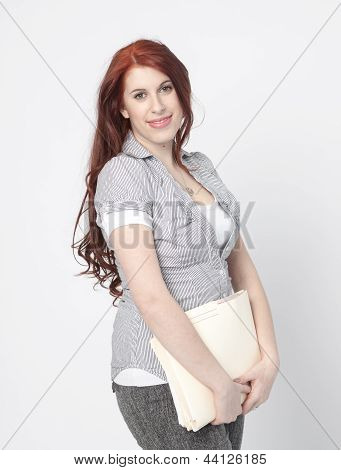 Business woman with a file folder , smiling