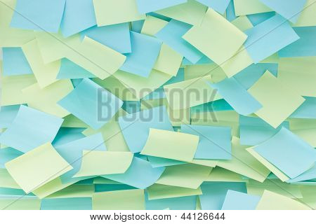 messy patterned wall of sticky notes