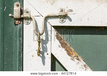 Closeup of a latch on a barn door