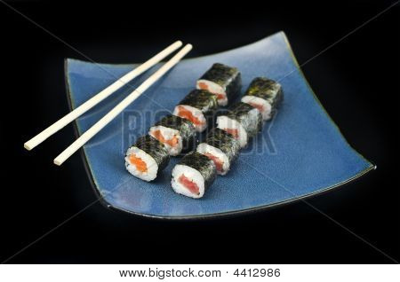 Sushi Philly Rolls Appetizer On Blue Plate W/ Chopsticks