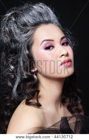 Portrait of young beautiful asian girl with vintage hairdo