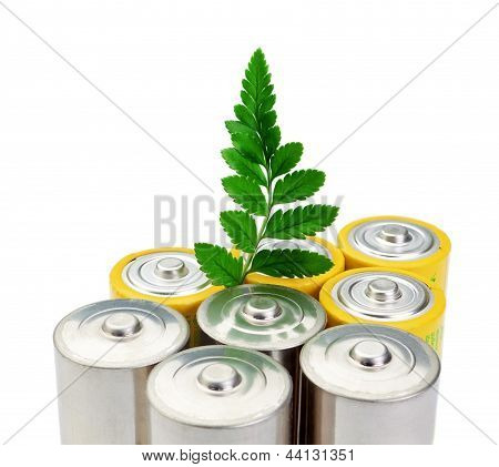 Alkaline Batteries And A Green Leaf Symbol Of Clean Energy.