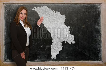 Teacher Showing Map Of Moldova On Blackboard