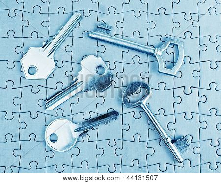 Different Types Of Keys On The Puzzle Close-up In Cold Tones.
