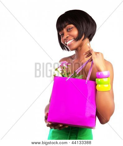 Cute American girl holding in hands pink shopping bag with fresh flowers isolated on white background, money spending concept