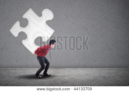 Businessman And Puzzle Piece