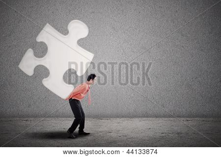 Businessman Building Puzzle