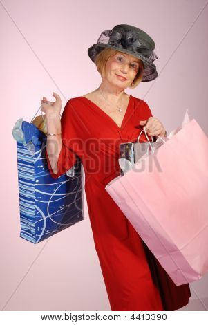 Attractive Lady Senior Citizen With Shopping Bags