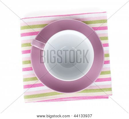 Violet coffee cup over kitchen towel. Isolated on white background