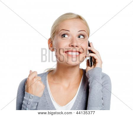 Smiley woman speaking on phone with her fist up, isolated on white