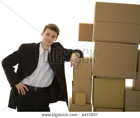 Man Lean One's Elbows On Cardboard Boxes