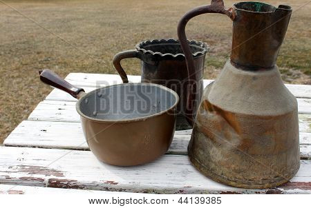 Old copper pots on wood table