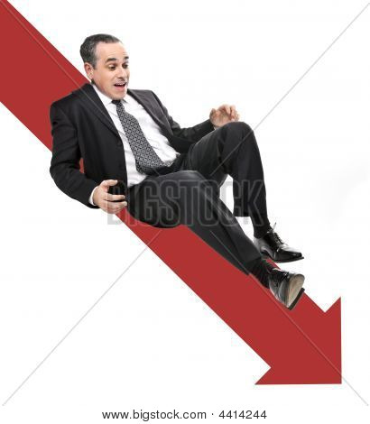 Businessman Sliding Down Red Arrow