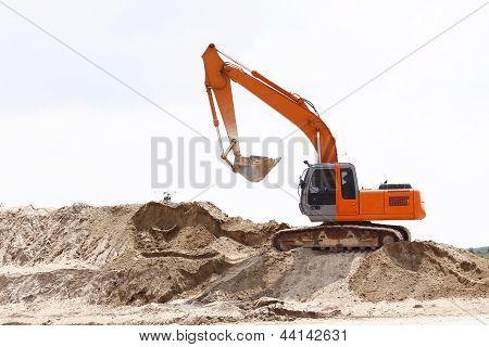 Excavator On Sand Pile