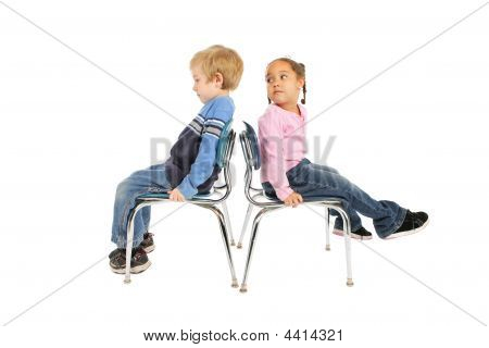 Two Children Sitting Back To Back
