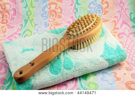 Wooden Brush With The Handle For Massage Of A Body And A Towel.