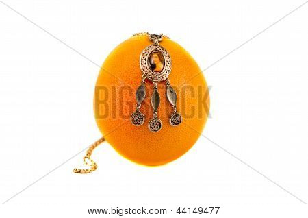 Necklace On Grapefruit Isolated On White