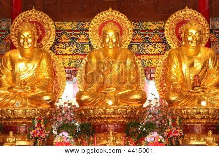 Three Golden Buddha Images.