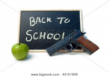 Back to school blackboard sign with an apple and a 9mm handgun signifying arming teachers