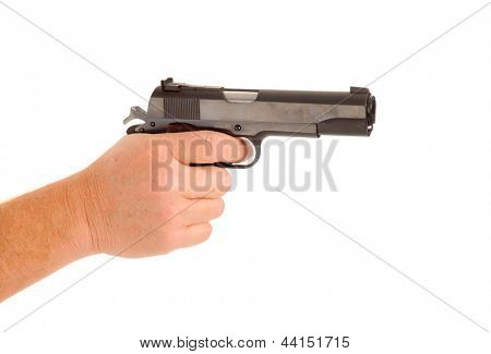 semi-automatic handgun cocked in a hand signifying handgun violence isolated on white