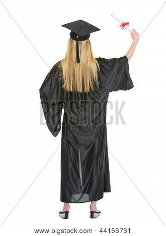 Full Length Portrait Of Young Woman In Graduation Gown With Dipl