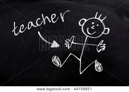 Happy Teacher on a Blackboard