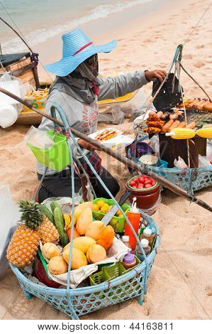 Thai Woman Selling Traditional Food At Beach