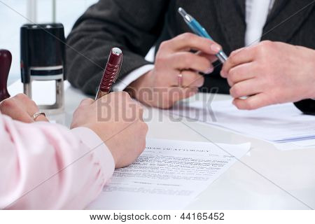 Hands of the woman signature document