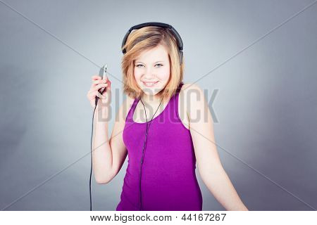 Dancing Happy Teenager Girl Listening To Music