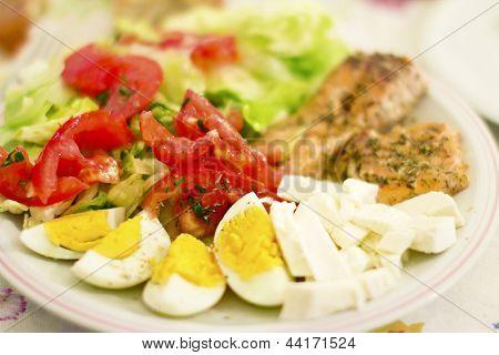 Rich Salad With Tomatoes, Eggs, Mozzarella, Salmon