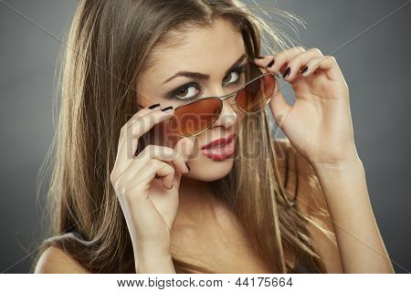 Woman Holding Sunglasses And Looking At You