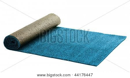 Artificial rolled light blue grass, isolated on white