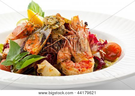Various Seafood Salad with Basil Leaf and Cherry Tomato