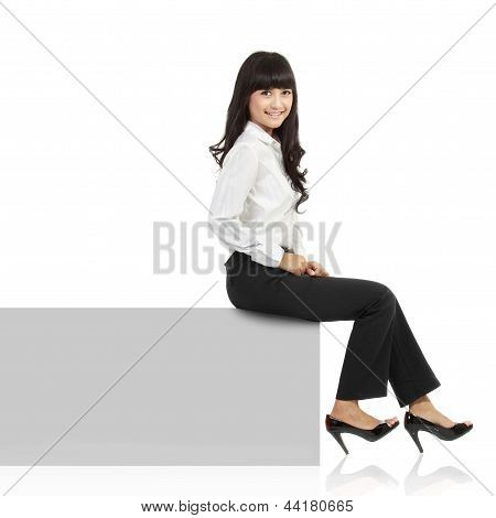 Woman Smiling Sitting On Horizontal Banner Edge. Happy Businesswoman Showing Sign With Lot Of Copy S