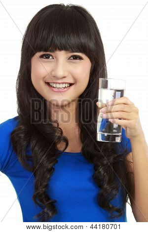 Beautiful Young Woman Drinks Clear Mineral Water From Glass.