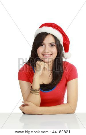 Young Woman In Red Wearing Santa Hat