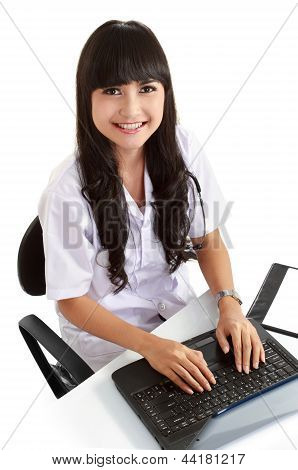 Female Doctor Working With Her Laptop