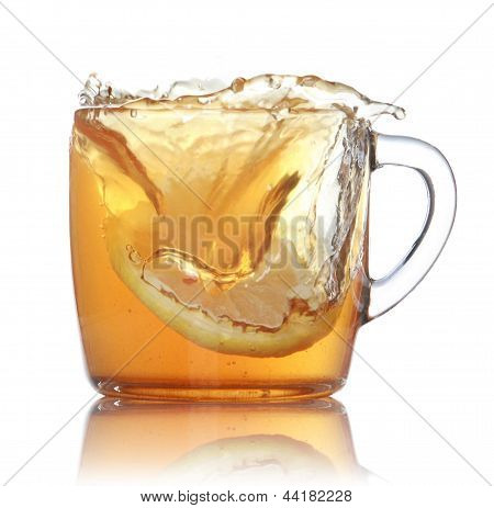 Lemon Slice Falling In To Glass With Ice Tea
