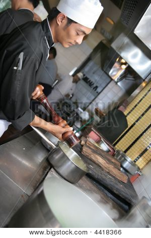 Chef Cooking In Restaurant