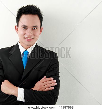 Business Man Lean Back Against The Wall